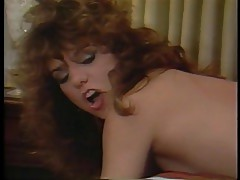 80s porn with John Holmes and big-hair brunette Kimberly Carson