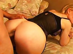 MILF Nina Hartley fucks young boy
