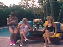 Christy Canyon & Rikki Blake at the pool.