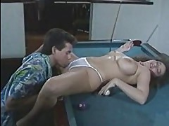 Man whore Peter North pleases a sexy slut naked on the table for some fucking