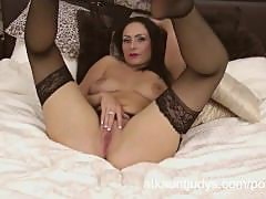 Sophia Delane is an erotic MILF in her lingerie, rubbing her pussy
